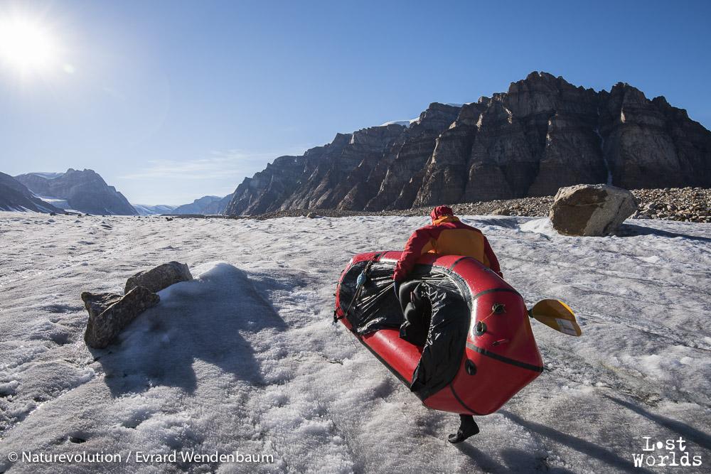 Evrard ready to raft down a rill on Edward Bailey glacier