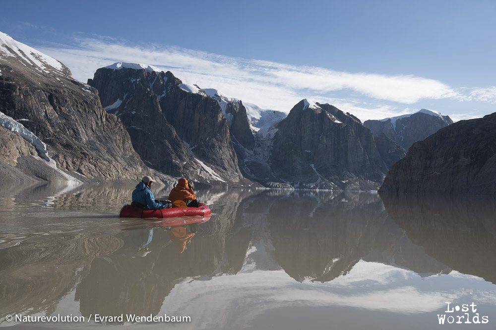 Packrafting across the Catalina Dal lake to explore a high point and get an overview of the landscape